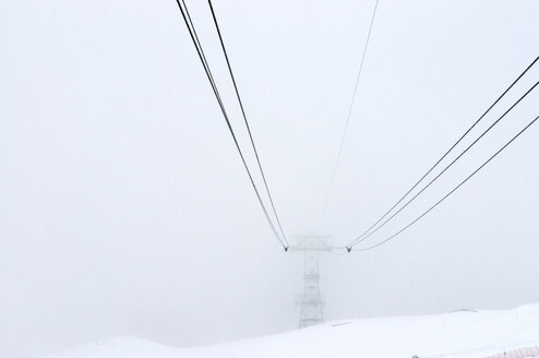 Switzerland, Arosa, Cable car in fog - AWDF000702