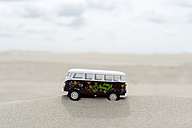 Germany, Amrum, Toy bus on dune - AWDF000728