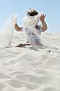Germany, Amrum, Boy playing with sand - AWDF000741