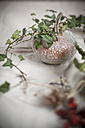 Halloween decoration, glittering pumpkin with ivy tendril on table - SBDF000335