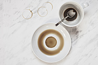 Cup of coffee with vestiges of coffee on white marble panel - SBDF000343