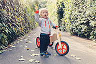 Germany, Bonn, Little boy with wood tricycle - MFF000608