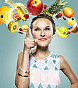 Young woman with flying fruits around her head, Composite - STKF000498
