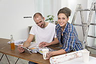 Young couple moving into new home, taking a break - FKF000299