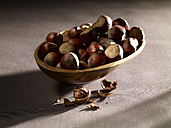 Hazelnuts in bowl, close up - SRSF000376