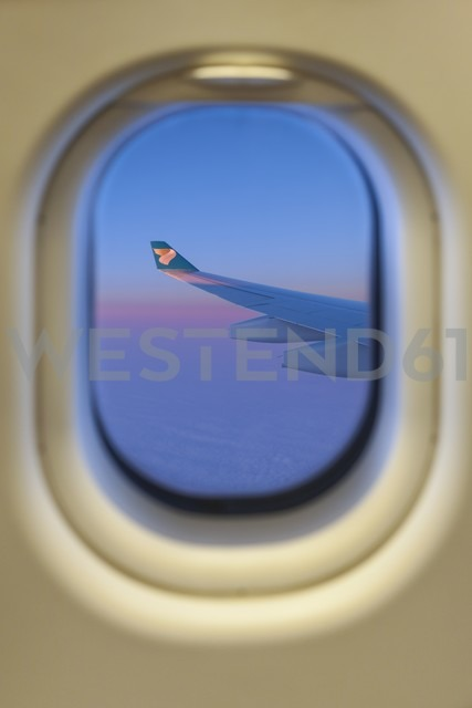 View of airplane wing through window - AM001168
