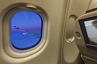 View of airplane wing through window - AM001169