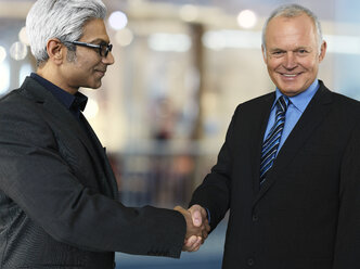 Portrait of two business partners shaking hands - STKF000518