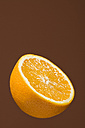 Half of orange (Citrus), studio shot - WSF000001