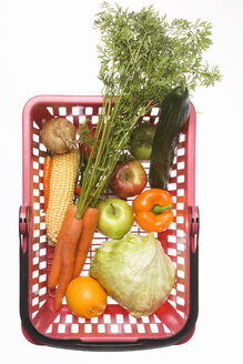 Shopping basket with differt vegetables and fruits, studio shot - WSF000043