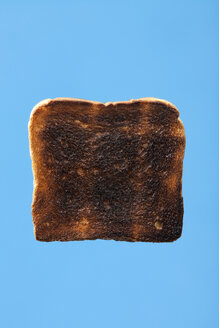 Slice of burned toast bread, studiio shot - WSF000040