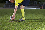 Soccer player placing ball on penalty spot - STKF000662