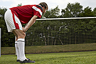 Exhausted soccer player on field - STKF000670