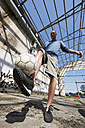 Man playing street soccer - STKF000677