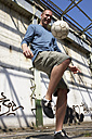 Man playing street soccer - STKF000679