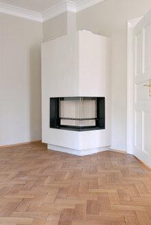 Germany, Fireplace in empty room - TKF000161