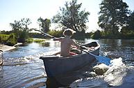 Germany, Brandenburg, Boy paddeling on Spree river - TKF000167