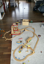 Germany, Berlin, Wooden toys on floor - TK000172