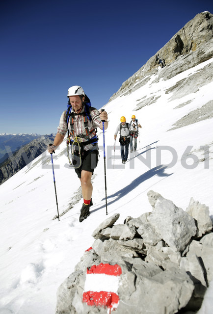 Austria, Tyrol, Karwendel mountains, Mountaineers crossing snowfield - TKF000186