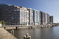 Netherlands, Amsterdam, Office buildings and library at town canal - WI000147