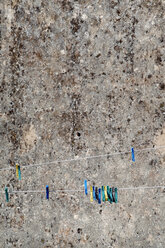 Spain, Clothespins in front of wall - JMF000260
