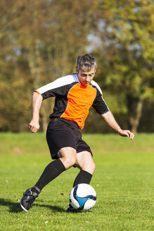 Soccer player with ball on field - STSF000217