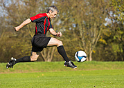 Soccer player with ball on field - STSF000214