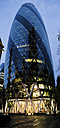 UK, London, London, 30 St Mary Axe, view to The Gherkin at dusk - DIS000174