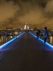 UK, London, view from Millennium Bridge to illuminated St Pauls Cathedral - DIS000197