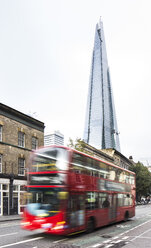 UK, London, view to the skyscraper The Shard and double-deck bus in front - DIS000154