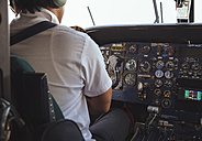 Pilot in the cockpit of a Dornier 228 - MBE000855