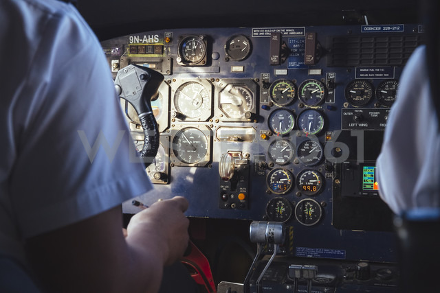 Two pilots in the cockpit of a Dornier 228 - MBE000856