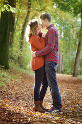 Happy young couple enjoying autumn in a park - BGF000037