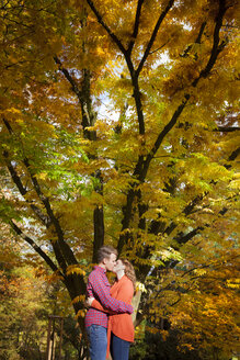 Happy young couple kissing in a park - BGF000026