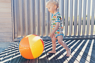 Little boy running after beach ball - MFF000678