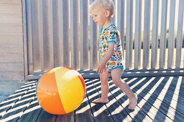 Little boy running after beach ball - MFF000678