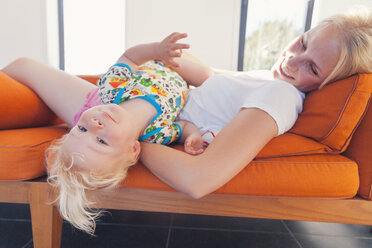 Little boy and his mother lying on the sofa - MFF000682
