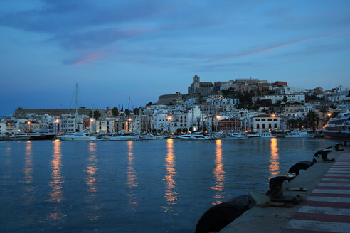 Spain, Ibiza, Harbour of Ibiza City at nightfall - OLE000006