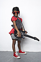 Girl with toy guitar wearing red heart-shaped sunglasses - FSF000297