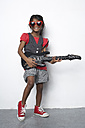 Girl with toy guitar wearing red heart-shaped sunglasses - FSF000298