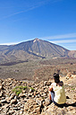 Spain, Canary Islands, Tenerife, Roques de Garcia, Mount Teide, Teide National Park, Female hiker in the Caldera de las Canadas - UMF000675