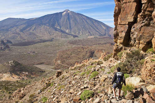 Spain, Canary Islands, Tenerife, Roques de Garcia, Mount Teide, Teide National Park, Female hiker in the Caldera de las Canadas - UMF000677
