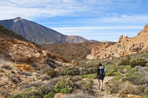 Spain, Canary Islands, Tenerife, Roques de Garcia, Mount Teide, Teide National Park, Female hiker in the Caldera de las Canadas - UMF000681