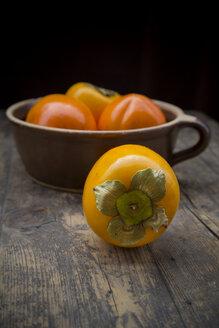 Kaki fruits in ceramic pot - LVF000341