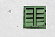 Spain, Lanzarote, Puerto del Carmen, Green shutter on house front - JATF000469