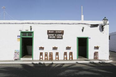 Spain, Lanzarote, Yaiza, Stools infront of tapas bar - JAT000460
