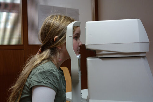 Germany, Freiburg, girl having eye test - DHL000200