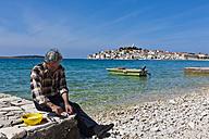 Croatia, Dalmatia, Primosten peninsula with fisherman - AM001282