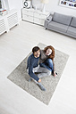 Germany, Munich, Couple sitting on  floor in living room - RBF001431