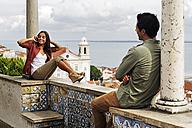 Portugal, Lisboa, Alfama, Miradouro de Santa Luzia, young woman telephoning - BIF000029
